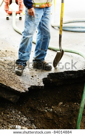 Standing on the edge of a excavation hole to repair a 12 inch water main failure on Harvard Ave in Roseburg OR - stock photo