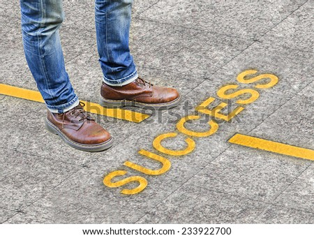 standing on walkway with Success  - stock photo