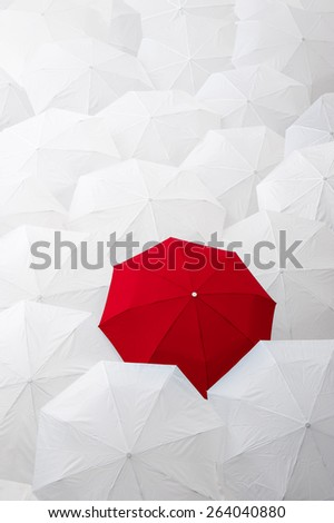 Standing out from the crowd. - stock photo
