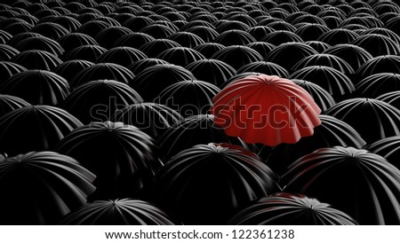 Standing out from the crowd, color umbrella over many dark ones - stock photo