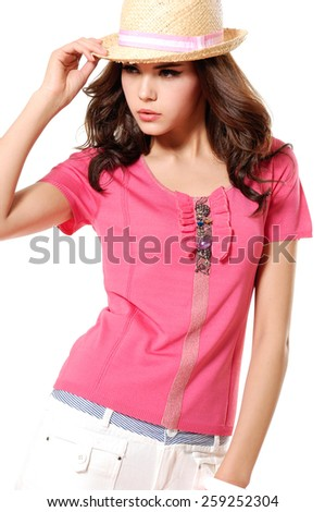 standing Portrait of young woman in cap posing  - stock photo