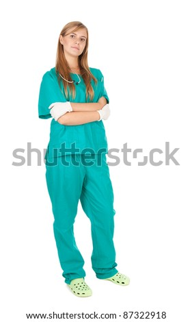 standing serious caring female doctor, full length