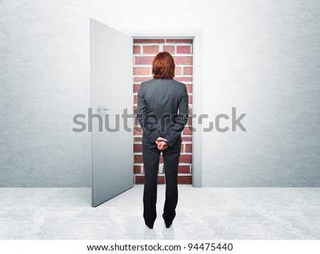 standing woman and closed door - stock photo