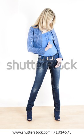 standing woman wearing blue clothes