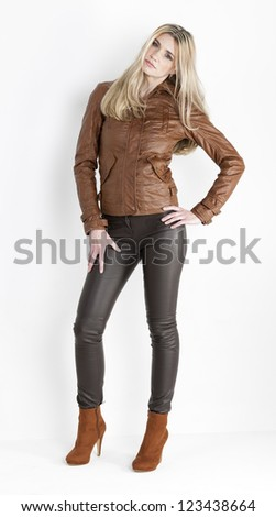 standing woman wearing brown clothes and fashionable brown shoes - stock photo