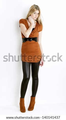 standing woman wearing fashionable brown shoes