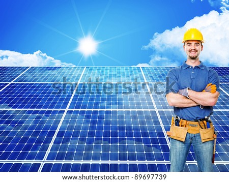 standing worker and solar panel background - stock photo