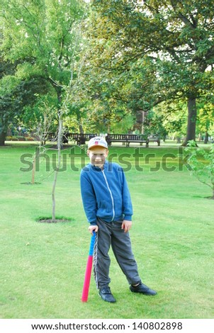 Standing young baseball player - stock photo