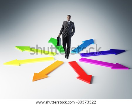 standing young businessman and colorful 3d arrows
