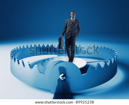 standing young businessman on 3d trap - stock photo