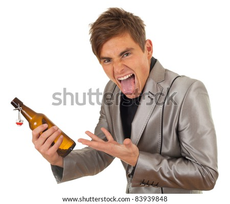 standing young man in grey suit with bottle of beer - stock photo