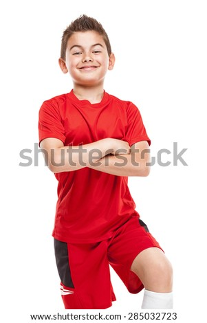 standing young soccer player in sportswear isolated over white background