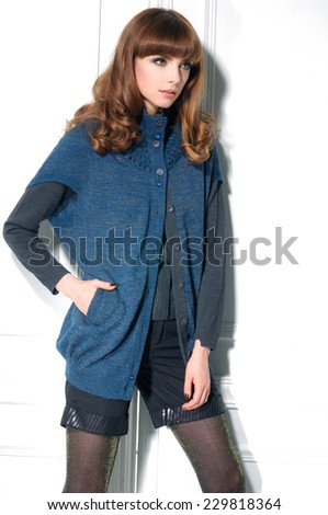standing young woman and shorts posing in studio - stock photo