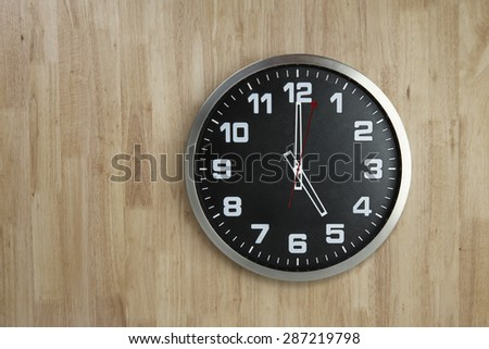 Standless Clock on Wooden Background, 5 O'Clock - stock photo