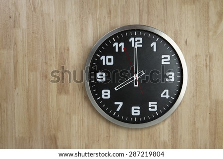 Standless Clock on Wooden Background, 8 O'Clock - stock photo