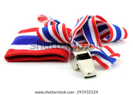 standless whistle and blue  with Thailand national flag lanyard in heart shape on white background - stock photo