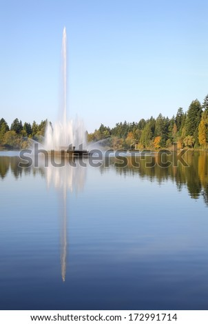 Stanley Park, Lost Lagoon Fountain, Vancouver vertical. The Jubilee Fountain in Stanley Park's Lost Lagoon. Vancouver, British Columbia, Canada.  - stock photo