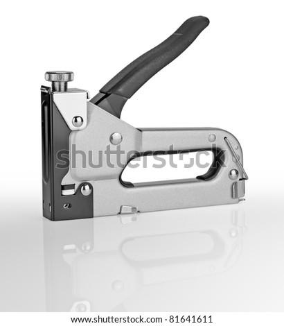 staple gun isolated on the white background - stock photo