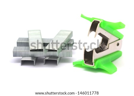 staple remover and staples  isolated on white background - stock photo
