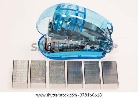 stapler and wire on white background