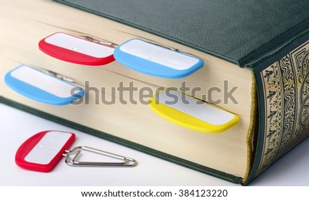 Staples with signs on a section of the book, close up, shallow DOF - stock photo