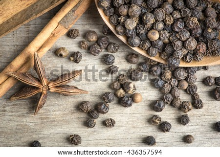 Star anise, cinnamon sticks,pepper on wooden background,spices stewed ingredients. - stock photo