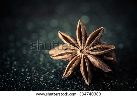 Star anise from close range on a black background - stock photo
