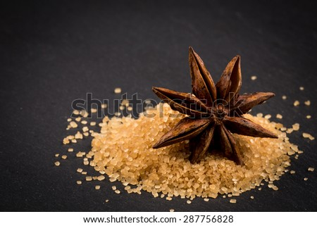 star anise on a background of the tropical brown sugar - stock photo