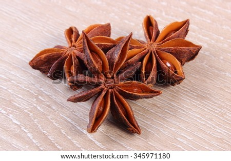 Star anise spice lying on wooden table, seasoning for baking - stock photo