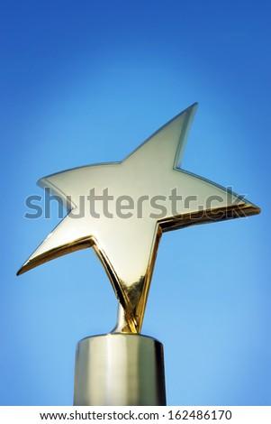 Star award against blue background - stock photo