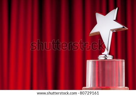 Star award against curtain background - stock photo