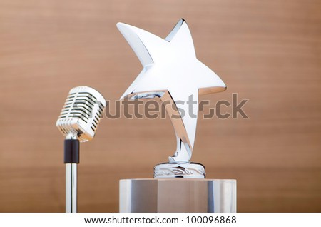 Star award against wooden background - stock photo