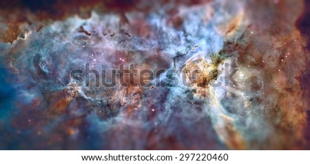 Star birth and death in the Carina Nebula. Space with stars, nebula and galaxy. Image with small depth of field. Elements of this image furnished by NASA. - stock photo