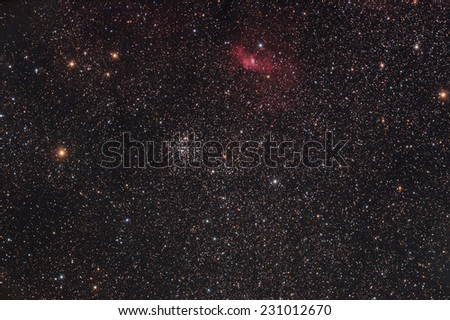Star cluster with nebulosity on a dark background. Photographed through a telescope. - stock photo