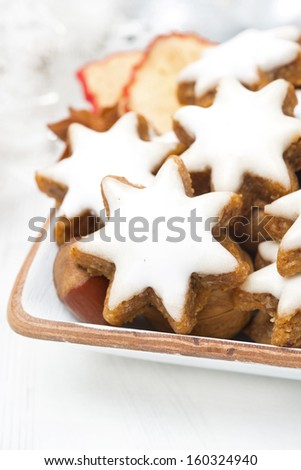 star cookies, nuts and spices for Christmas, selective focus, close-up - stock photo