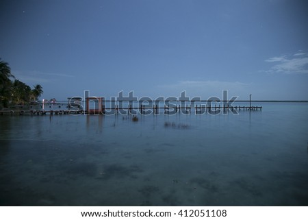 STAR NIGHT AT THE DOCK IN BACALAR, MEXICO - stock photo