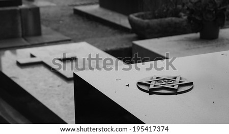 Star of David and Cross on the marble tombstones. Montparnasse Cemetery in Paris (France) Aged photo.  Black and white. - stock photo