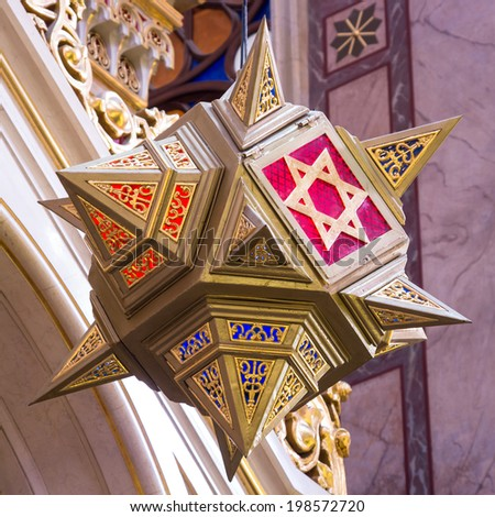 Star of David hanging over the altar of Dohany street Synagogue at Budapest, Hungary - stock photo