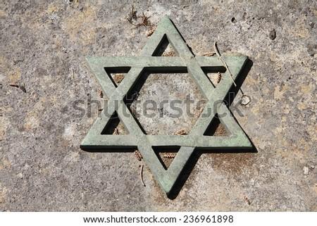 Star of David - Jewish symbol on an old Hebrew grave in Campo Verano cemetery, Rome. - stock photo