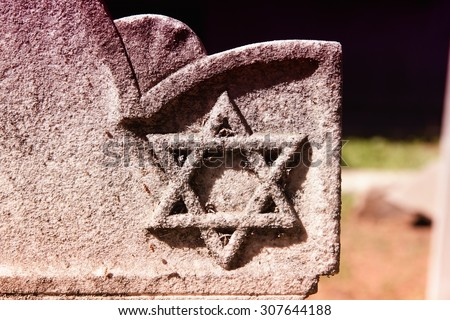 Star of David - Jewish symbol on an old Hebrew grave in Campo Verano cemetery, Rome. Filtered color style. - stock photo