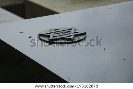 Star of David on marble tombstone. Montparnasse Cemetery in Paris (France) - stock photo