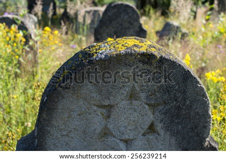 Star of David on the gravestone in the old Jewish cemetery in the Ukrainian Carpathians - stock photo