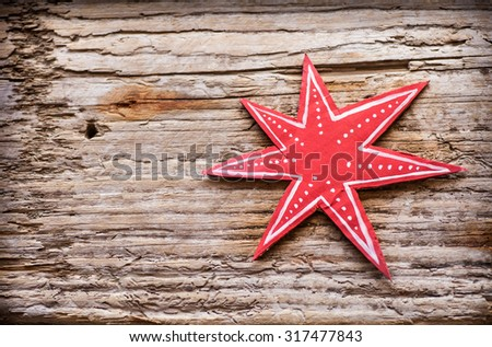 Star - paper Christmas decoration Christmas decoration over grunge background/vintage paper handmade christmas decoration and snow on wooden background with copy space.