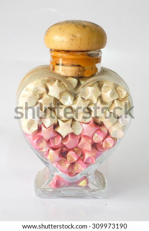 Star paper in bottle  - stock photo