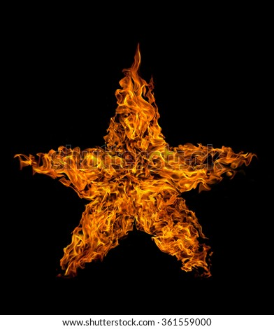 Star shape fire flame on black background - stock photo