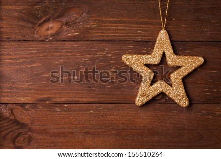 star shape on wooden background with copy space   - stock photo