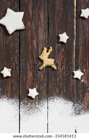 Star shaped Christmas cookies on wooden background