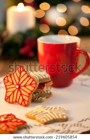 Star shaped Christmas cookies on wooden table - shallow DOF - stock photo