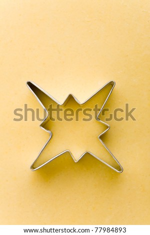 Star shaped cookie cutter on a raw cookie dough
