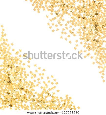 star shaped golden confetti on white background. festive background - stock photo